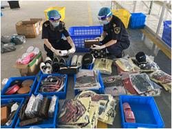 深圳龙岗海关在出口跨境电商渠道查获侵权鞋包269件